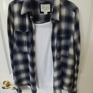 Blue, black, and white checkered flannel shirt